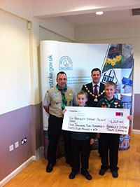 Ben Walker presenting a cheque to 1st Bradley Stoke Scout Group