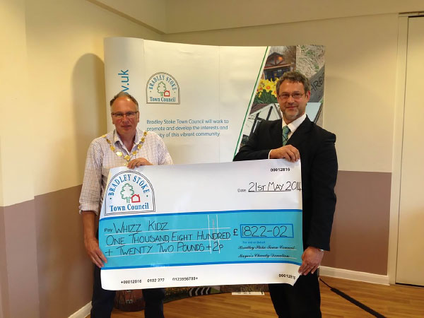 Former Mayor Councillor Brian Hopkinson presents a Charity Cheque to 'Whizz Kidz' (Pictured Mike Walmsley).