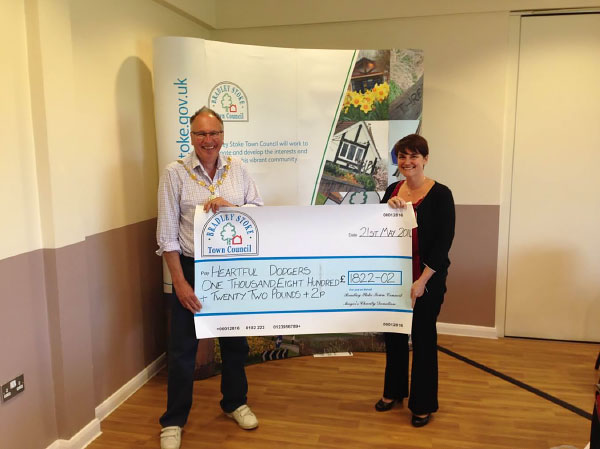 Former Mayor Councillor Brian Hopkinson presents a Charity Cheque to 'Heartful Dodgers' (Pictured Louise Hill).
