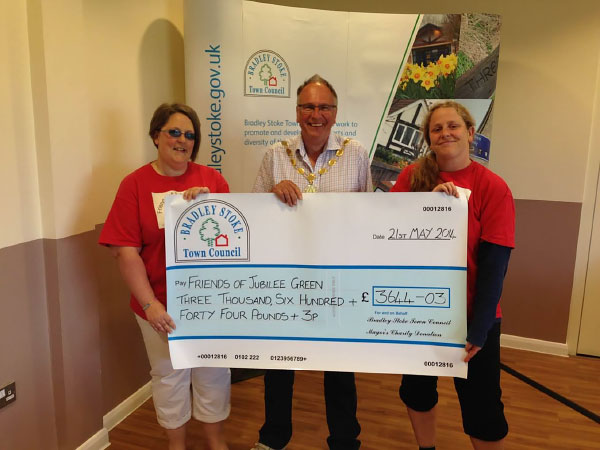 Former Mayor Councillor Brian Hopkinson presents a Charity Cheque to 'Friends of Jubilee Green' (Pictured Michelle Dent & Helen North).