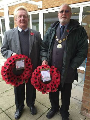 Councillor John Ashe and the Town Mayor, Councillor Roger Avenin; with wreathes to be laid at the Service. Photograph courtesy of Councillor Franklin Owusu-Antwi.